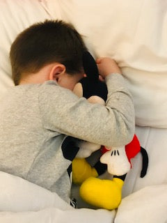 sleepy boy at disneyland paris