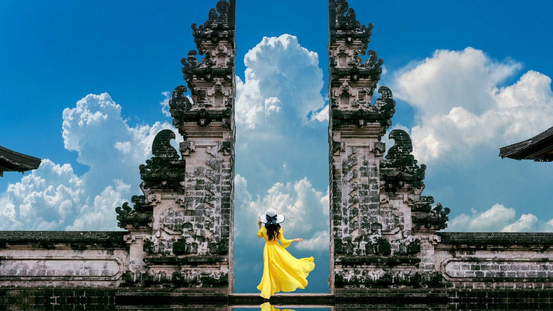 A girl framed in the temple gates, Bali, Indonesia