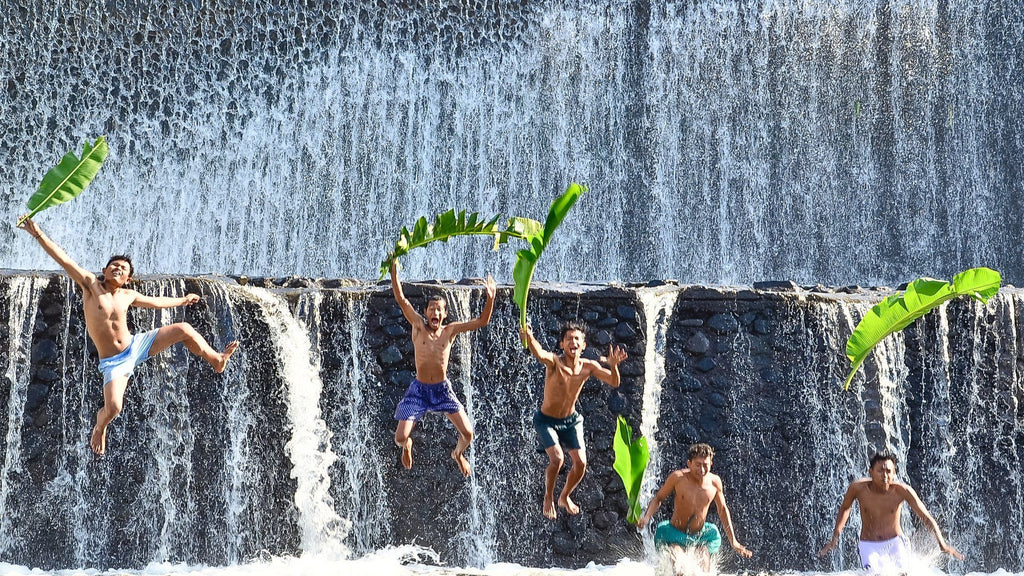 People having fun in a waterfall in Bali