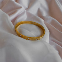 Gold Cartier bangle gems