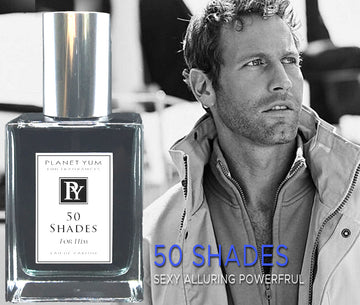 handsome man in casual jacket on a yacht showing bottle of 50 Shades perfume by Planet Yum