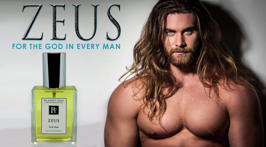 Zeus Perfume for Men by Planet Yum showing large chested long haired blue eyed model