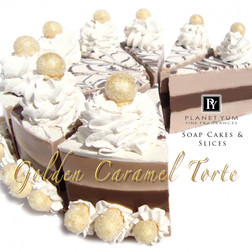 Whole natural goat milk soap cake called Golden Caramel Torte with beautiful caramel & white tones and soap piping with glittering golden balls on cream puffs.