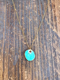 Gold edged turquoise circle pendant