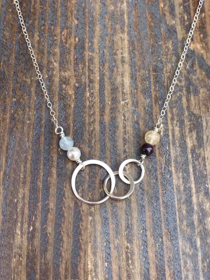 Custom birthstones on silver infinity circle necklace
