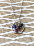 Personalized birthstones suspended in silver hexagon