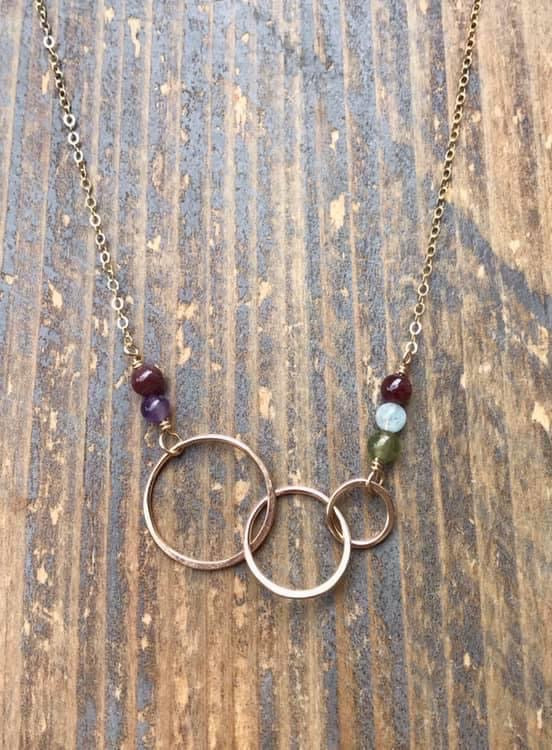 Gold infinity four circle necklace