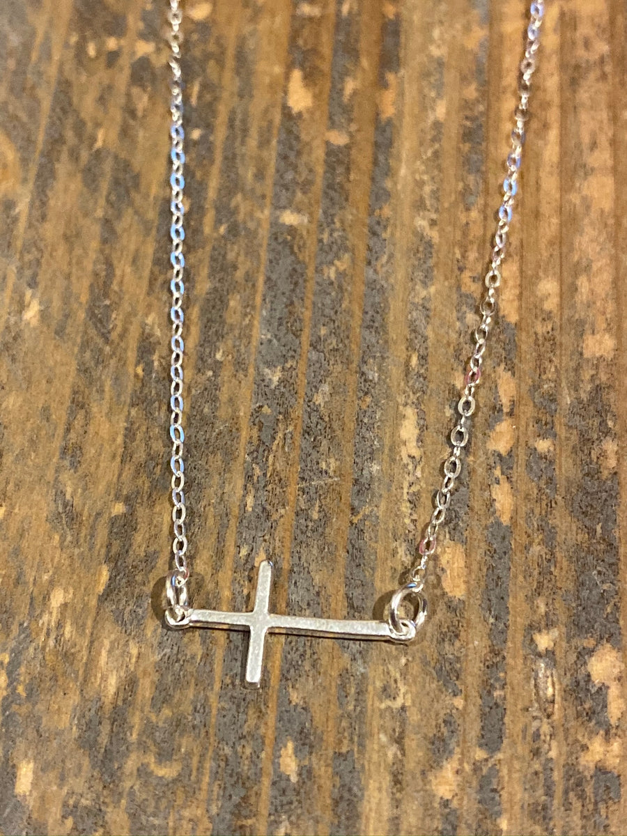 Silver sideways cross necklace