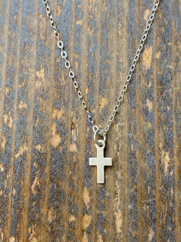 Gold tiny cross necklace