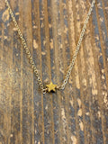 Gold small solid star necklace
