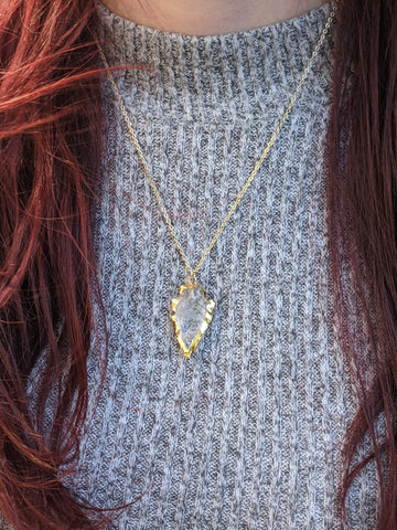 Gold clear quartz arrowhead edged in gold