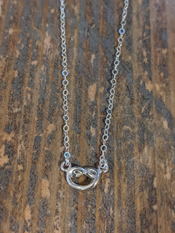 Silver heart knot necklace
