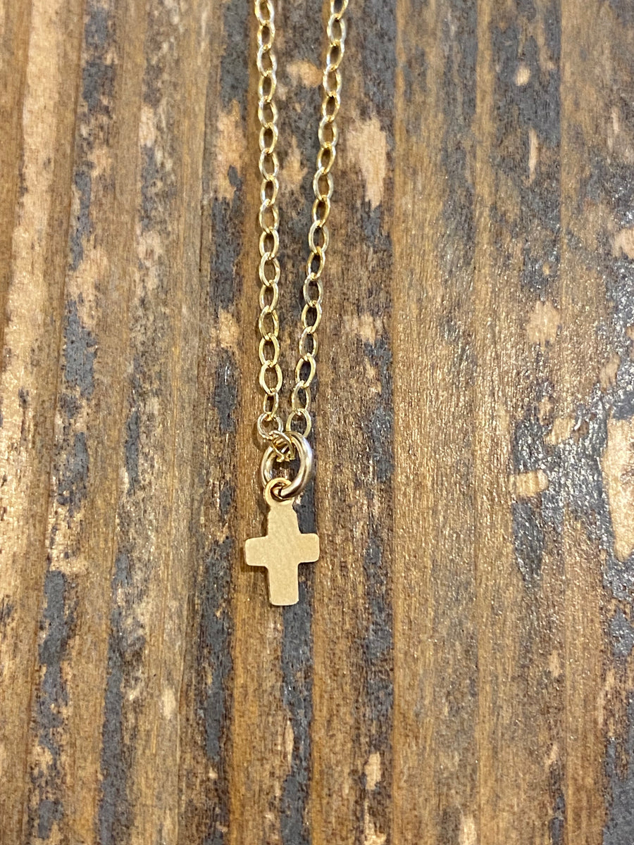 Gold teeny tiny cross necklace