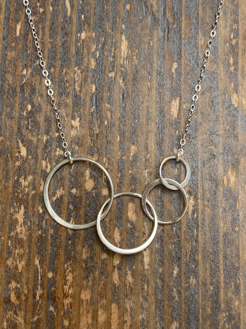 Silver infinity four circle necklace