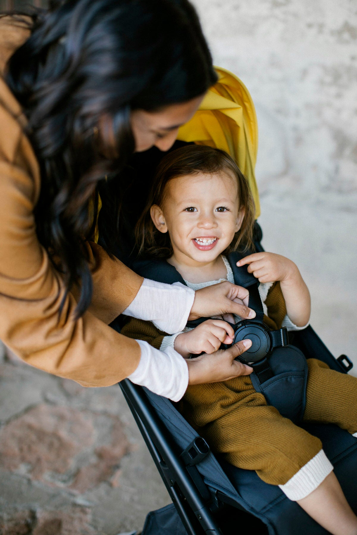 Hendrix smiles at camera from the Peli stroller