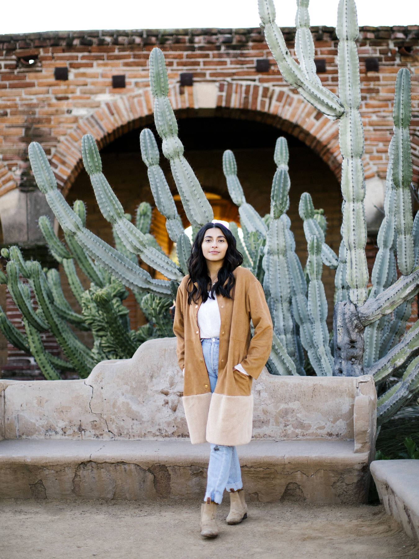 Valerie Metz standing in front of large cactus