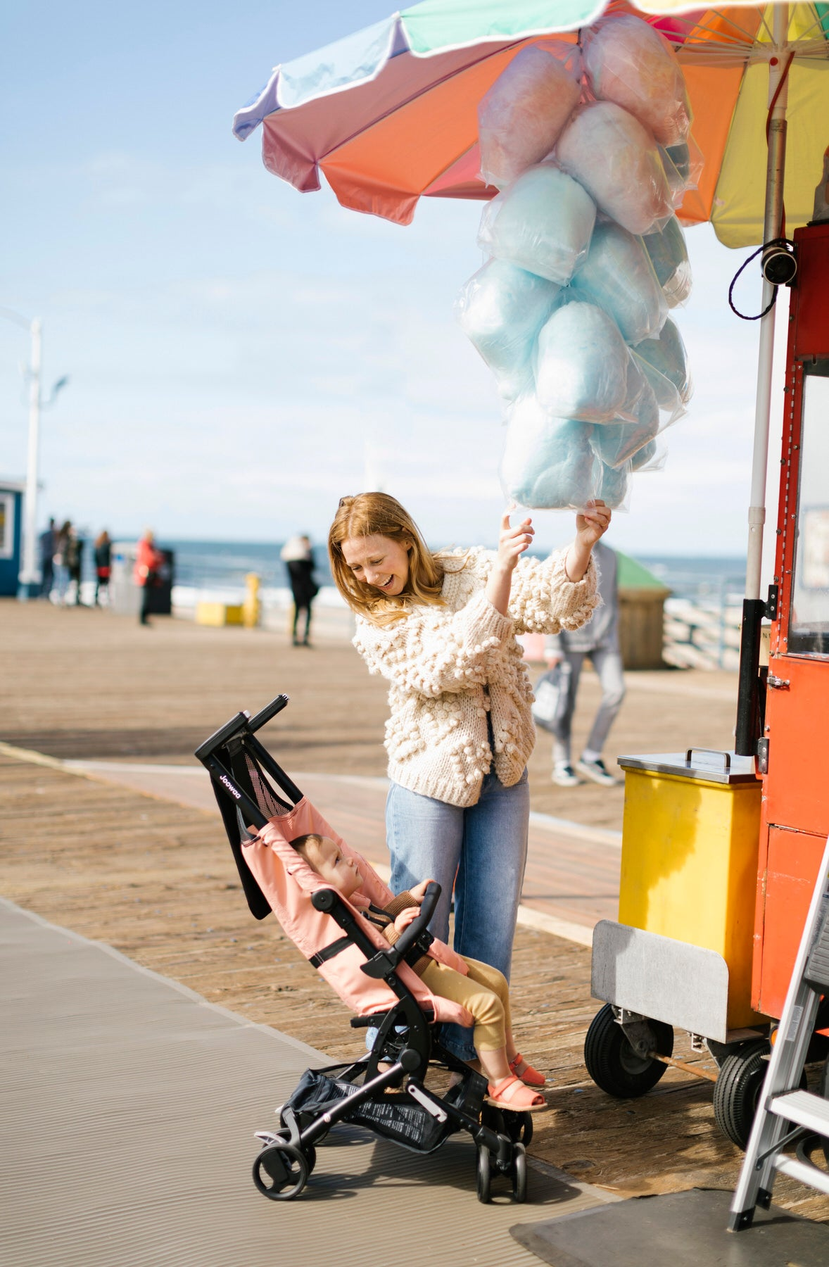 Hannah, picking out cotton candy, at Malibu Pier