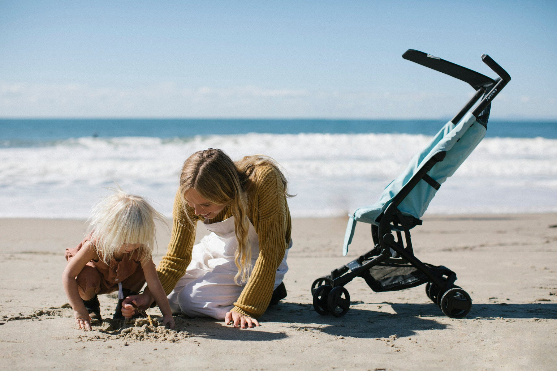 Leah and daughter play in the sand