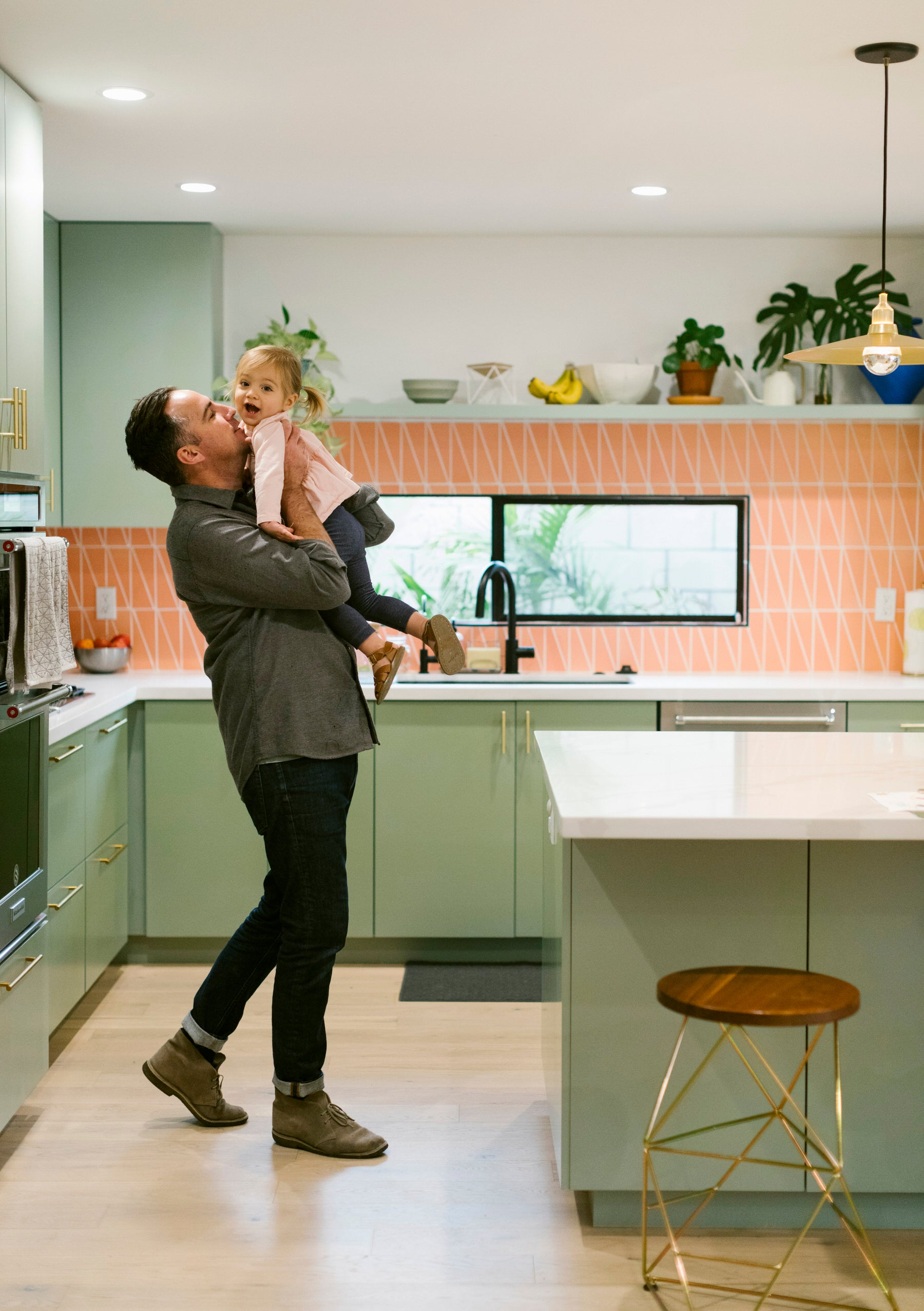 Eric and his daughter in their kitchen