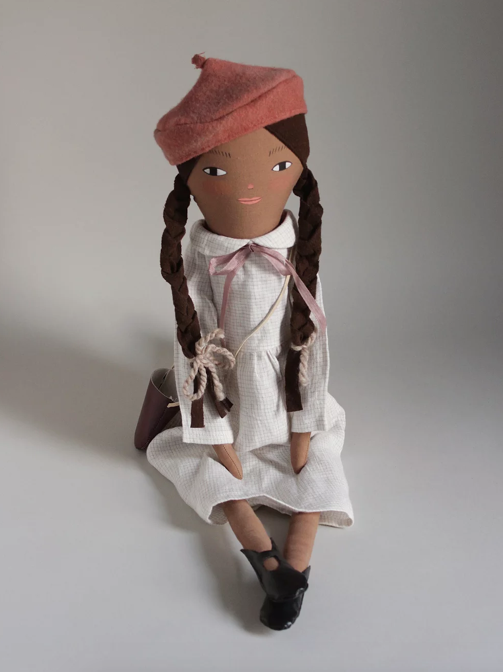 Izzie doll wearing beret from Merrilee Liddiard's shop
