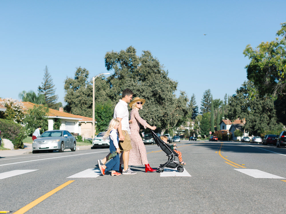 Brooke White and her family taking a stroll in their Southern California neighborhood with the Poppy stroller by Joowaa.