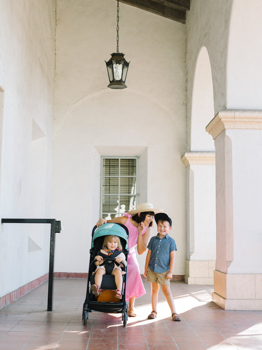 California Spanish architecture surrounds Erin and her family as they take a walk with the Peli stroller.