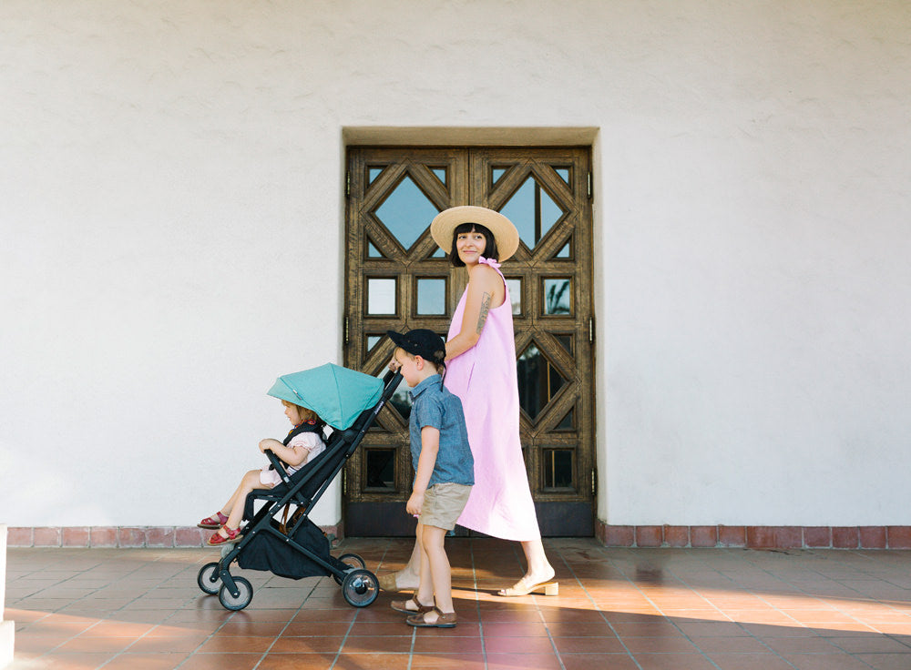 Erin grew up in Redlands, California and returned to raise her children there. Here they take a walk with their Peli stroller by Joowaa.