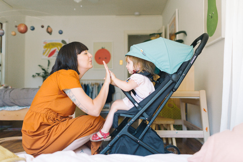 Erin Perez Hagstrom and her daughter Edith share a fun moment while getting Edie into her Joowaa Peli stroller.