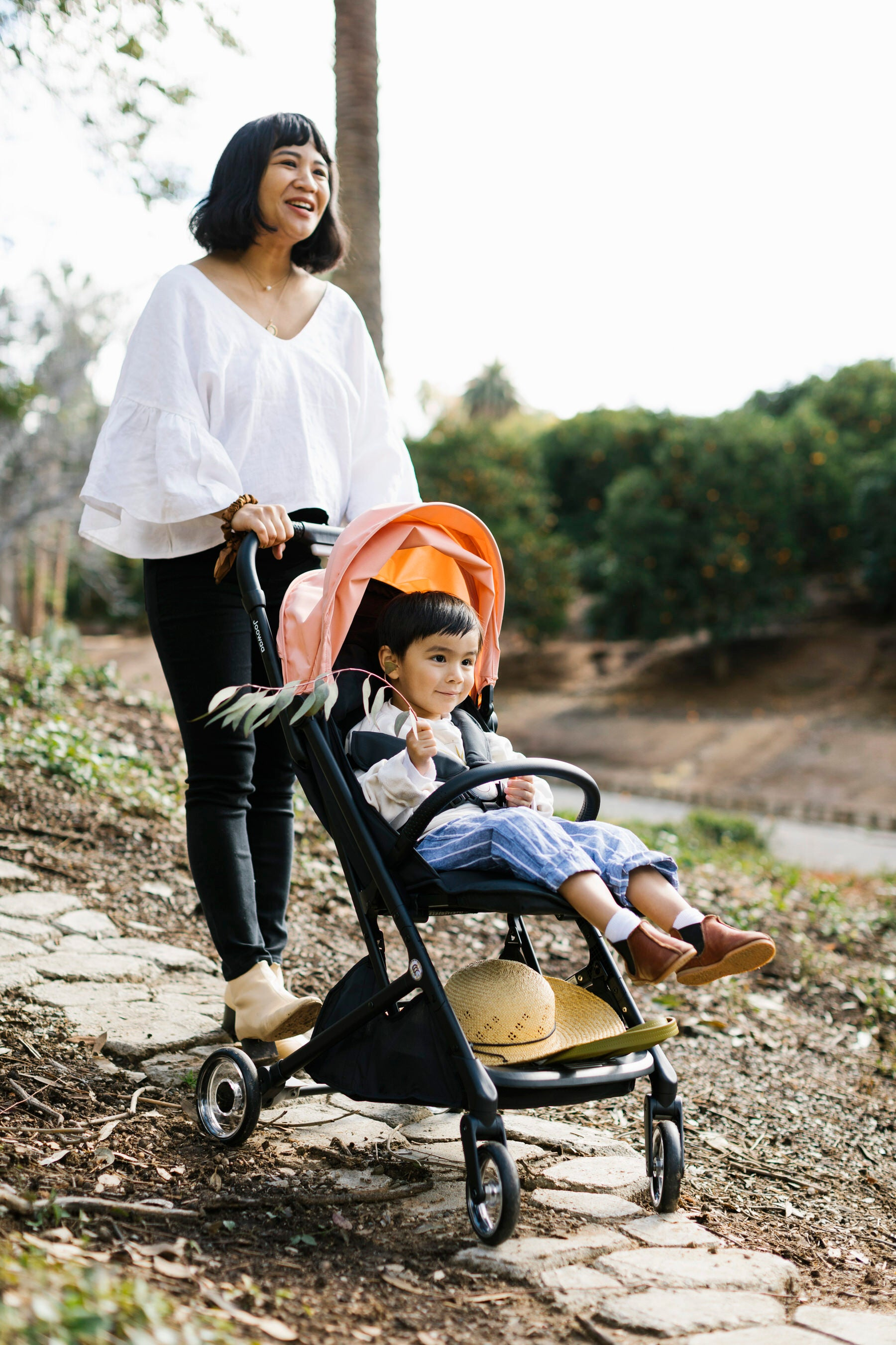 Melissa and son stroll along a nature trail
