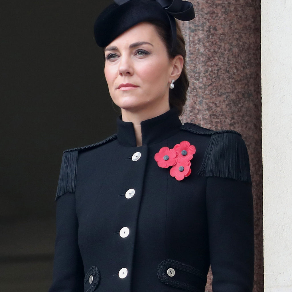 Though on opposite sides of the Atlantic Ocean right now, sisters-in-law Kate Middleton and Meghan Markle both opted for a similar aesthetic to mark Remembrance Sunday over the weekend.