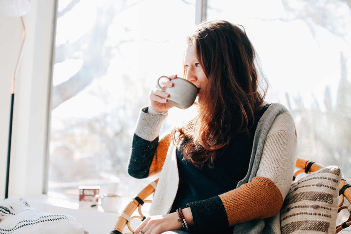 Woman enjoying the benefits of functional mushroom coffee