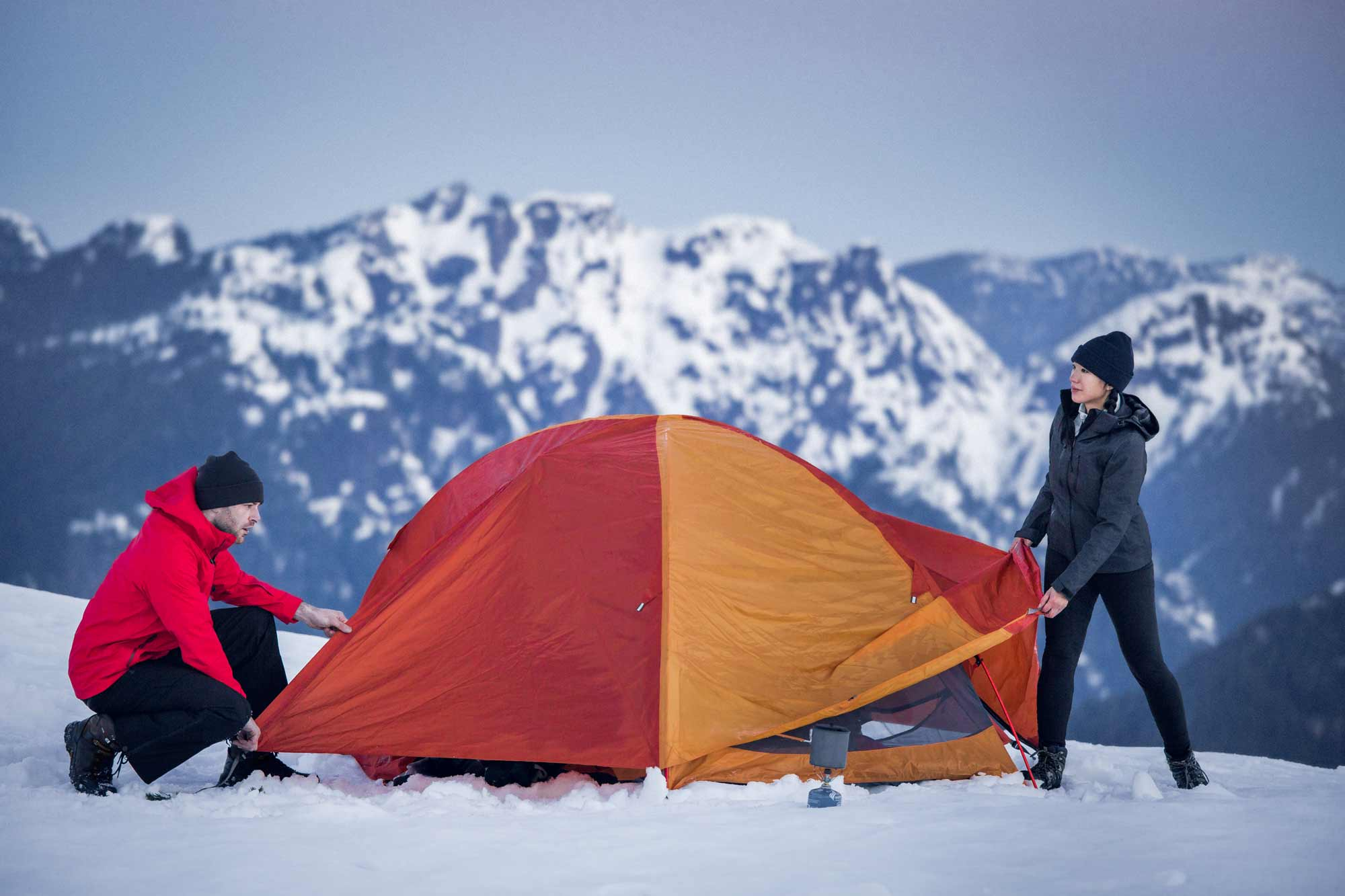 Adele and Thierry setting up a tent in the mountains of British Columbia