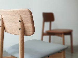 Plong chair with upholstery