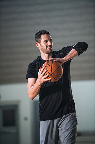 Kevin Love Holding Basketball