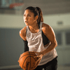 Female Basketball Player Wearing Trash Talker Mouthguard about to Shoot a Free Throw