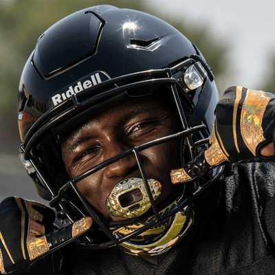 Football Athlete Wearing  Showtime Gold Tribal Football Chinstrap Along With Lipguard