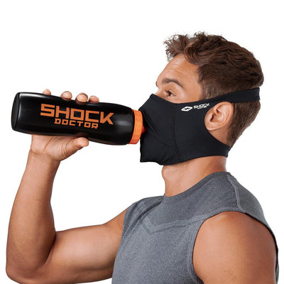 Black Play Safe Face Mask – Male Model Wearing Protective Safety Face Mask while Drinking a Hydration Water Bottle - Left Angle