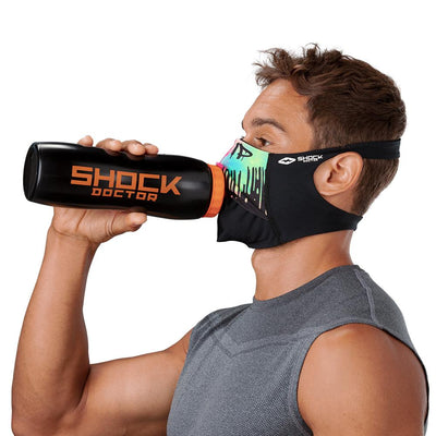 Drip Play Safe Face Mask – Male Model Wearing Protective Safety Face Mask while Drinking a Hydration Water Bottle - Left Angle