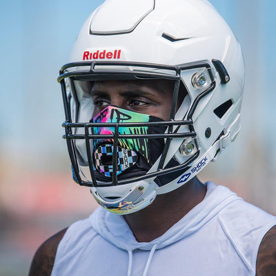 Drip Play Safe Face Mask Lifestyle Image  – Male Football Player With Helmet on Wearing Protective Safety Face Mask - Left Angle