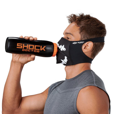 Black White Fang Play Safe Face Mask – Male Model Wearing Protective Safety Face Mask while Drinking a Hydration Water Bottle - Left Angle
