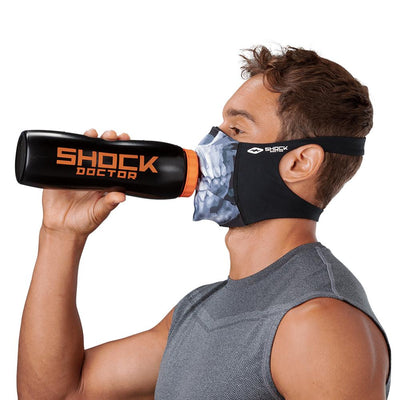 Skull Play Safe Face Mask – Male Model Wearing Protective Safety Face Mask while Drinking a Hydration Water Bottle - Left Angle