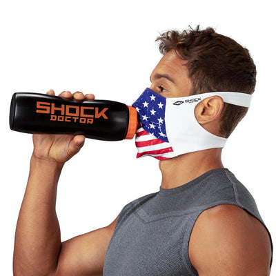 USA Stars & Stripes Play Safe Face Mask – Male Model Wearing Protective Safety Face Mask while Drinking a Hydration Water Bottle - Left Angle