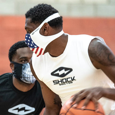 USA Stars & Stripes Play Safe Face Mask – Male Basketball Player Wearing Protective Safety Face Mask During Game - Left Angle