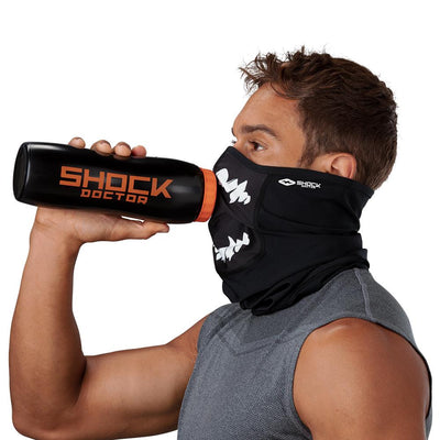 Black White Fang Play Safe Neck-Face Gaiter – Male Model Wearing Protective Safety Face and Neck Covering while Drinking a Hydration Water Bottle - Left Angle