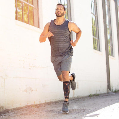 Male Runner Wearing Shock Doctor Runners Therapy Shin Splint Sleeve on a Jog