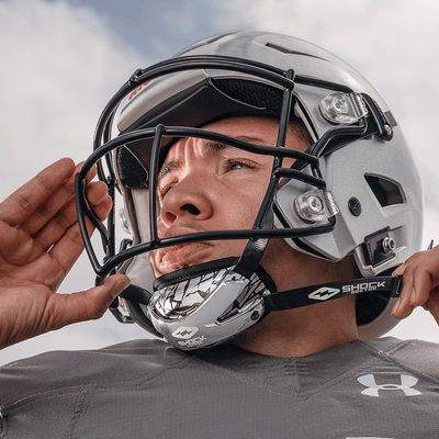 Football Athlete Securing Showtime Shattered Football Chinstrap to Helmet