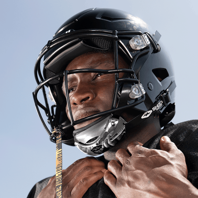 Football Athlete Wearing Showtime Chrome Silver Football Chinstrap with Football Tether Attached to Helmet
