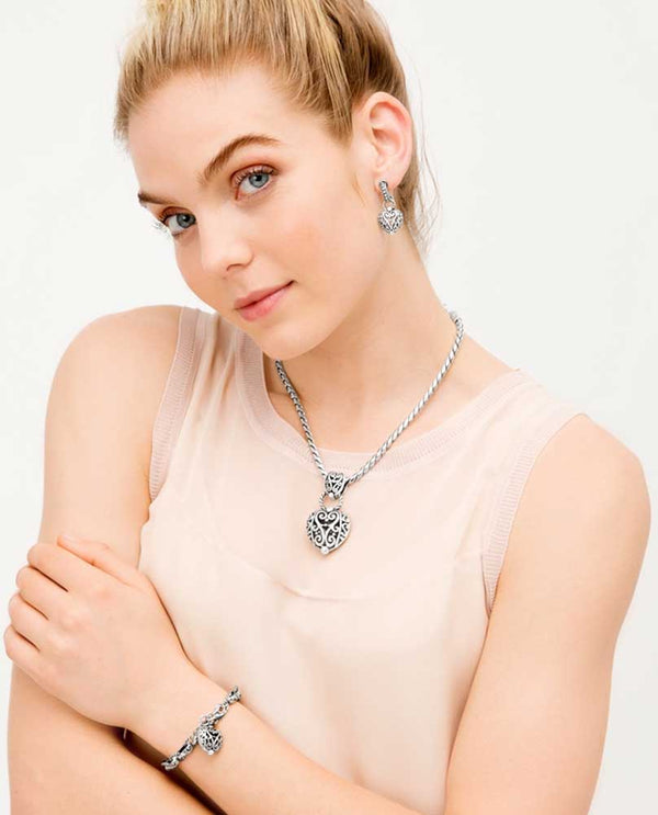 Model wearing Silver Brighton J44500 Bibi Heart Necklace heart pendant hanging from a rope chain