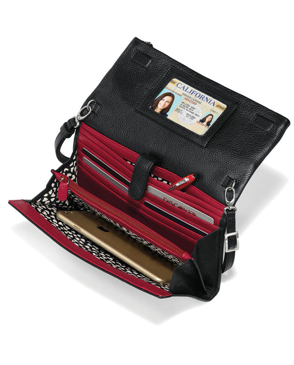 Interior of Brighton T4385M Kiss Me Flap Organizer Detail in Black Multi features fun artwork by Tom Clancy