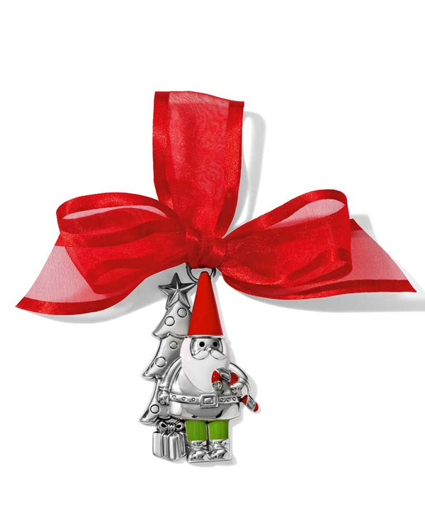 Brighton G70810 Gnome Christmas Ornament is a silver gnome standing in front of a Christmas tree